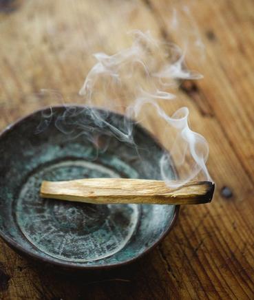 burning palo santo stick